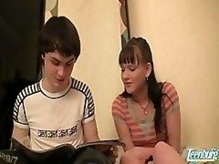 Youthful Couple Alone In Bedroom