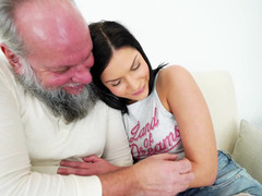 A raven haired babe is with an old guy, getting male orgasm by him