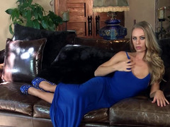 A bitch in a sexy blue dress is massaging her wet and tight pussy