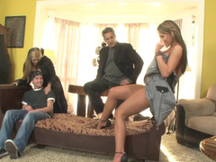 Two girls and two guys are having group sex in this scene