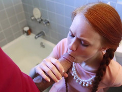 A redhead with pigtails is making one dude really happy