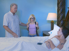 A bimbo with glasses is with her stepsister in the bed, fucking