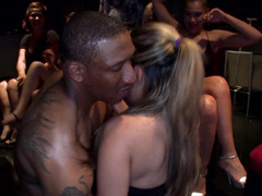 Crazy hot party girls sucking on hard stripper cock at the club