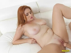 Redhead babe Lennox Luxe makes love on the sofa