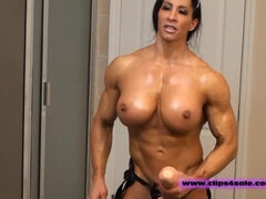 Buxomy dame with muscles, Angela Salvagno is dressed in a cord- on and frolicking with it