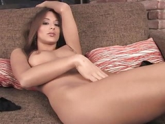 Brunette in sofa with sizeable labia
