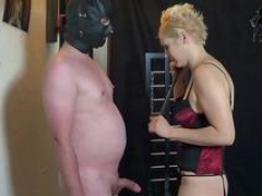 Blond female domination in black stockings during rough german spanking fetish session