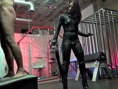 Whipped by hot mistress in leather