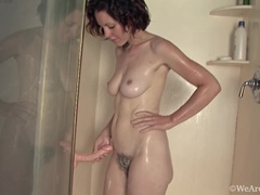 Hairy girl Candy Smith plays with shower pal