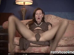 Redhead MILF jilling off in dark pantyhose