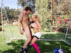 Sportswoman and her coach on the football field
