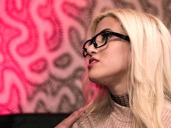 Bigtitted blonde with glasses is giving a blow job to her man