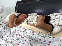 Frisky brunettes wake up together and moreover embark fucking in bed