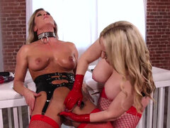 Stacked mistress Aiden Starr treats busty lesbian sex slave Ariel X to some kinky anal domination