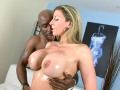 A hot sexually available mom with large titties is getting a big black dick in her mouth