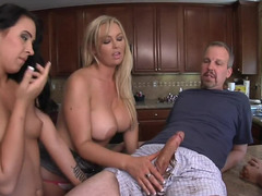 Sexy dames are having group intercourse with two lads in the kitchen