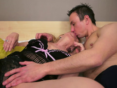 A blonde granny that loves cum cannon is giving a blow job to her partner