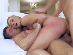 Blonde that has a sizeable ass is getting two big cocks in her ass