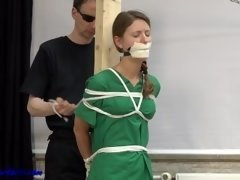 Nurse pinioned and tape gagged