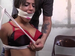 submissive brunette with big boobs tied up in BDSM video