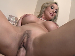 A blonde soccer mom is getting penetrated missionary style by her stepson