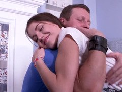 A brunette with pigtails is pressed against the chair and furthermore fucked