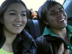 Alluring Oriental chick fools aournd with her boyfriend in the car