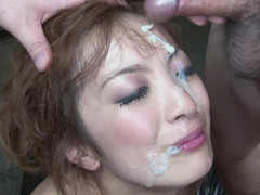 Japanese babe is down on her knees, sucking off blokes