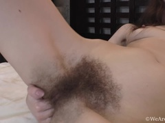 Enjoy Lisa Li stripping and masturbating on a bed