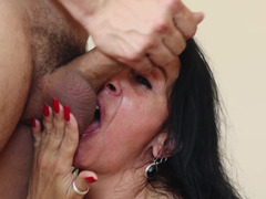 A raven haired granny is getting a sizeable phallus inside her mouth
