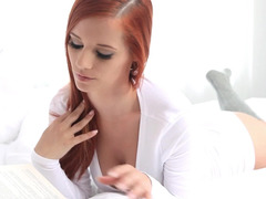 A redhead slowly takes off her clothes and moreover she touches her twat