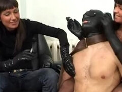 Two mistresses whipping and cock torturing their masked ashtray boy