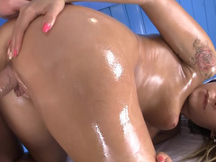 A brunette that loves fuck pole is getting massaged and furthermore oiled up