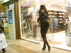 Russian dame in short skirt and besides high heel boots spying