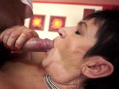 A overweight granny is getting cock juice in her mouth during a blow job