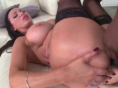 Voluptuous brunette is smoking and sucking dick