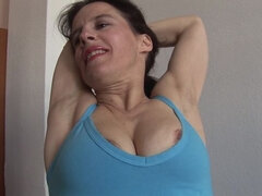 Hairy housewife stretches before mastubating