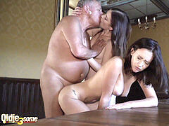 Grandpa humps 2 young femmes in their sexy holes and watch them licking cum