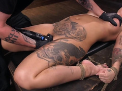 Tattooed blonde with fake tits withstands dominant man's tests