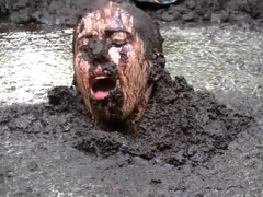 Busty Samantha gets very dirty outdoors in pool of mud