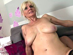 Super mom with sizeable saggy tits takes young and fresh cock