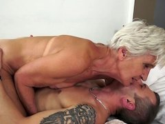 A nasty grown-up short haired granny is blowing off a big hard pecker