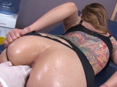 Tattooed babe is getting her ass fingered