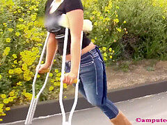 Amputee Kylie in jeans crutching around