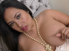 Asian curvy housewife Amy Latina showing off her big tits
