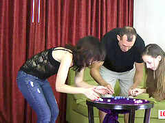 Two beauties and one guy have fun a game of unclothe roll the dice