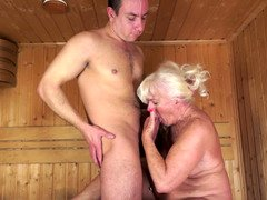 Dirty old blonde is getting fucked hard in the sauna today