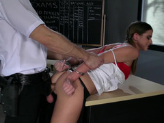A brunette that has big tits is getting fucked on the desk