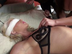 Sensually restrained blonde treated to a wild FFM double penetration