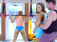 A pair of cute sportswomen perform 3-way in the gym